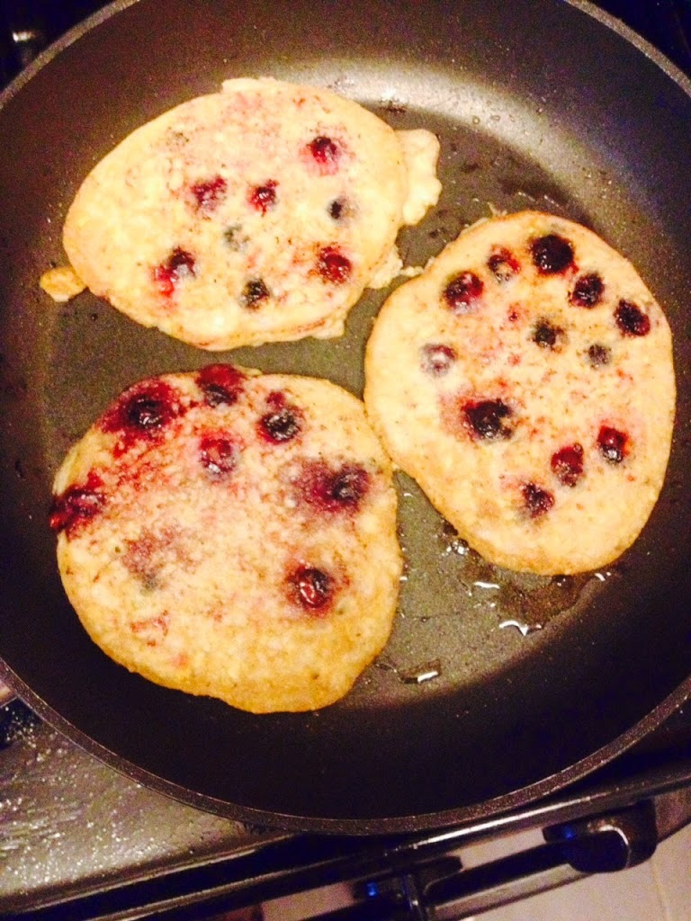blueberry pancakes cooking on the pan