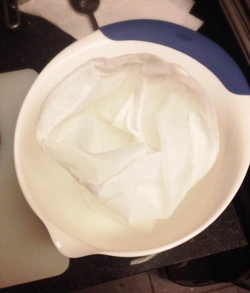 nut milk bag inside a bowl to make hemp seed milk