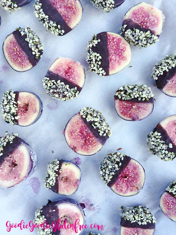 Gluten-Free, Vegan and Paleo chocolate covered figs dipped in hemp seeds with coconut oil. It's the perfect treat!
