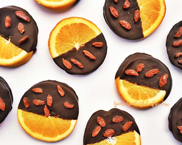 dark chocolate orange slices with superfood goji berries. A delicious paleo, vegan and sugar-free treat that is easy to make! By Julie Rosenthal at Goodiegoodieglutenfree.com