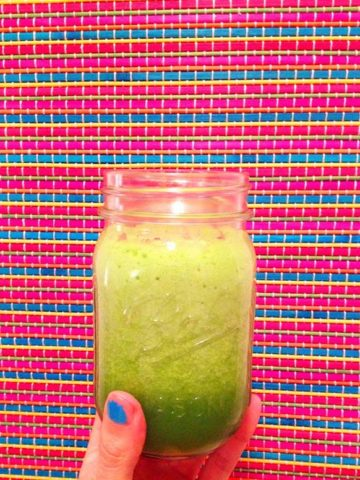 festive cucumber apple green juice in a mason jar