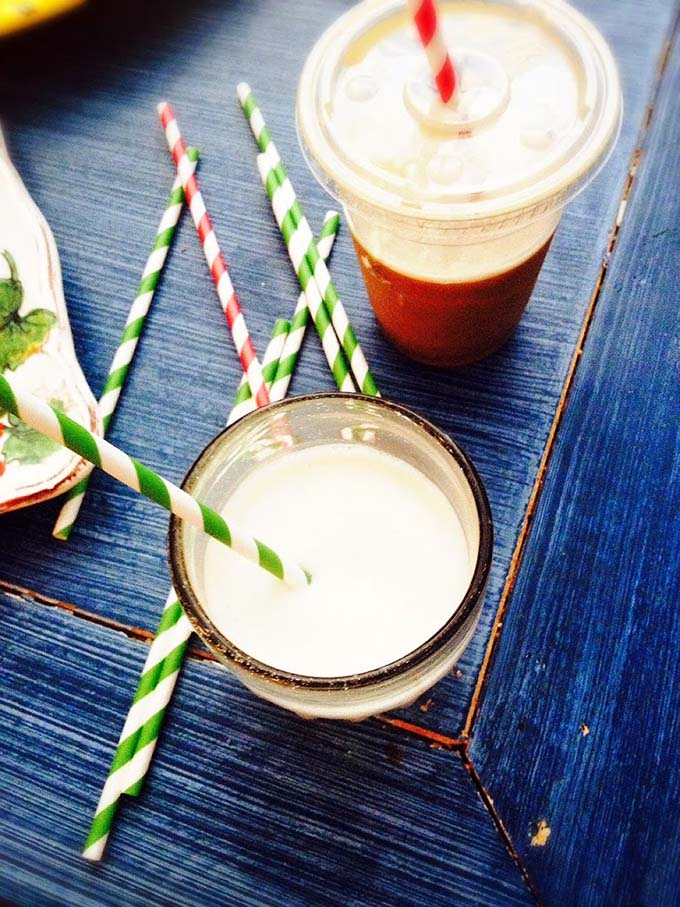 quinoa milk in a glass on its own and in an iced coffee